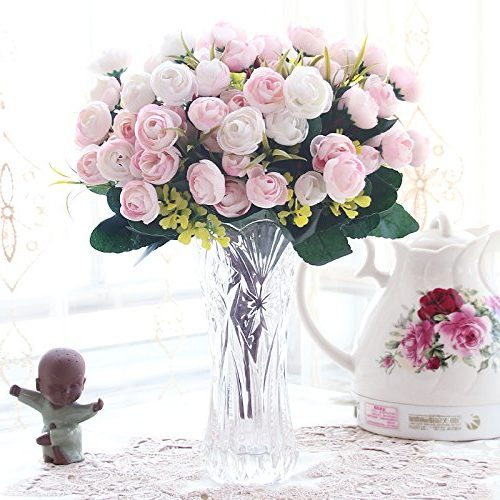 Centro jarrón de cristal con ramillete de flores