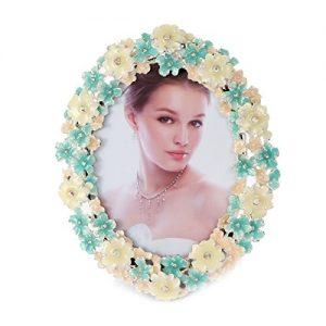 Marco de fotos damara elíptico con flores de metal decorativas