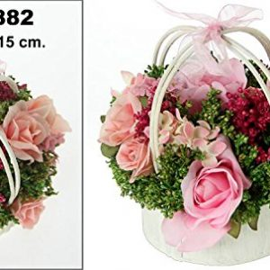 centro de flores en colores rosas