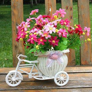 Triciclo con cesta de flores para decoración