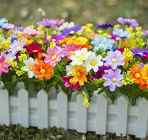Centro en forma de vallas para decorar mesas de jardín